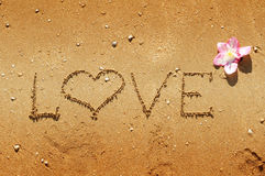 Love message written in sand. Love message written in golden sand Royalty Free Stock Photos