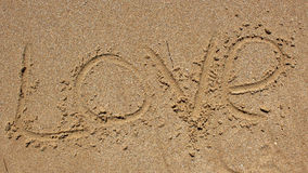 Love message written in sand Royalty Free Stock Images