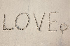 Love message written in sand Stock Image