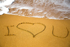 Love message written in sand Royalty Free Stock Photography