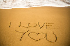 Love message written in sand Stock Photos
