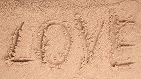 Love message written in sand Royalty Free Stock Photos
