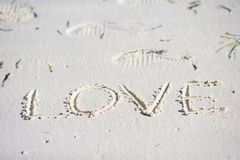 Love message written in a sandy beach Stock Photography