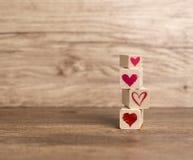 Love message written in wooden blocks. Love, Hearts, Valentine`s Day, Love background Heart background Stock Photos