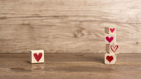 Love message written in wooden blocks. Love, Hearts, Valentine& x27;s Day, Love background Heart background Royalty Free Stock Image