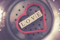 Love message written with wooden blocks inside a red heart Stock Photos