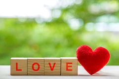 Love message written in wooden blocks. Stock Photography