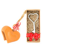 Love metal in box and heart shape baked clay Stock Photo
