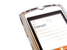 Love on mobile phone. A love message on a mobile phone. White background Royalty Free Stock Photography