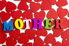 Love mom. Hearts lying on the white floor of their letters mom Royalty Free Stock Images