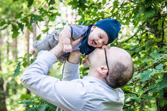 Love moments between father and son in forest park Royalty Free Stock Photography