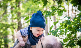 Love moments between father and son in forest park Royalty Free Stock Photo
