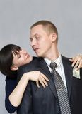 Love and money. Woman gets money from his jacket pocket men. Picture abstraction Stock Image