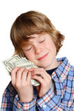 Love of Money. A boy hugging his money Royalty Free Stock Photography