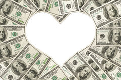 The love of money. One hundred dollar bills in the shape of a heart  on white background with copy space for your message, The love of money Royalty Free Stock Photos