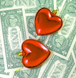 Love for money concept. Love on the calculation. Love for money concept. Two glass hearts on dollars background Royalty Free Stock Photo