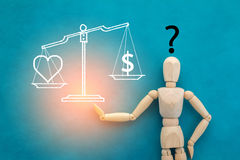 Love or money decision concept Royalty Free Stock Images