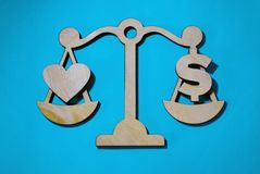 Love or money on scales, stock photos