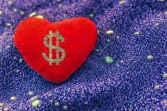 Love or money. Sign dollar on red heart royalty free stock photography