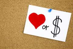 Love or money sticky note pinned to a cork notice Stock Image