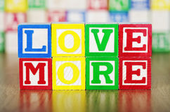 Love More Spelled Out in Alphabet Building Blocks Stock Photography
