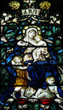 Love (mother with three children) in stained glass Stock Photo