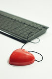 Love mouse. A lady holds a heart shaped mouse for on-line dating Stock Image