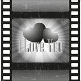 Love in the movies. Love heart on the background of film vector illustration