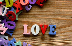 Love multicolored   letters   on   wood Stock Photo