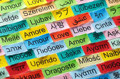 Love multilingual word. LOVE  Word Cloud printed on colorful paper different languages Stock Photos