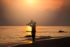 Love of mum silhouette on sunrise. Thailand Royalty Free Stock Photo