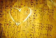 Love Music. Light heart on vintage music sheet Royalty Free Stock Photo