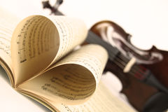 Love music. A Violin with the music sheet Royalty Free Stock Photography
