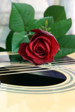 Love of music 3. Rose on top of guitar with leaf stock images