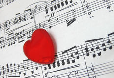 Love for music. Concept for love of music with a shaped heart over a music sheet royalty free stock photos