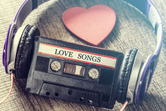 Love music concept. Listen to your heart. Love music concept with audio tape cassette and a red heart Royalty Free Stock Photos