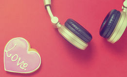 Love Music heart with golden headphone Stock Photos