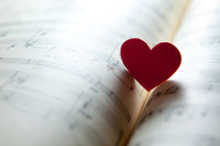 Love for music. Heart shape on a music note book. shallow DOF Royalty Free Stock Images