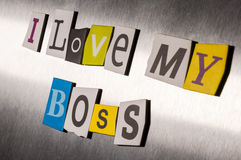 Love my boss written with color magazine letter clippings on metal background. Design for business relationship and work Royalty Free Stock Photography