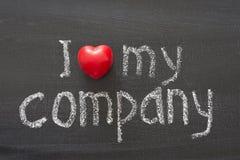 Love my company. I love my company phrase handwritten on school blackboard Royalty Free Stock Photos