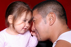 Love my Daddy. Father adn Daughter looking lovingly at each other Royalty Free Stock Photos