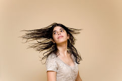 Latin teenager wildly moving her long hair after a Stock Photo