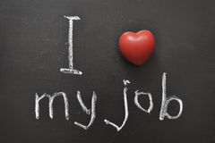 Love my job. I love my job -  positive concept handwritten on black chalkboard with volume red heart symbol Royalty Free Stock Images