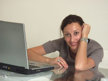 Love my job. Working Woman smiling with notebook PC Royalty Free Stock Photography