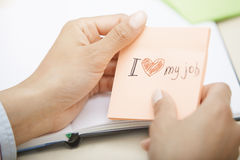 Love my job text on adhesive note Royalty Free Stock Images