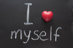 Love myself. I love myself phrase handwritten on the school blackboard Royalty Free Stock Photos