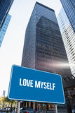 Love myself against skyscraper in city Royalty Free Stock Photo