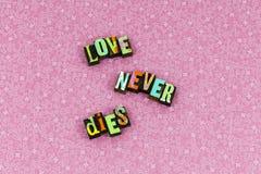 Love never dies faith appreciation letterpress. Love never dies faith appreciation typography letterpress true relationship hope friends romance family trust stock image