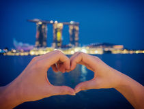 Love at the night of Singapore. Before the marina bay sands Stock Photos