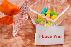 Love Note. A love note sitting beside a candy dish with a bow on it Stock Photos